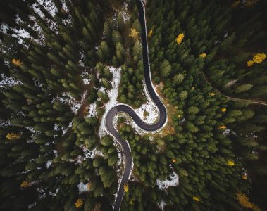 bird s eye view of roadway surrounded by trees