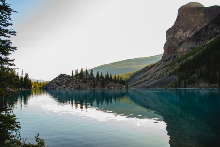 calm lake with mountain terrain